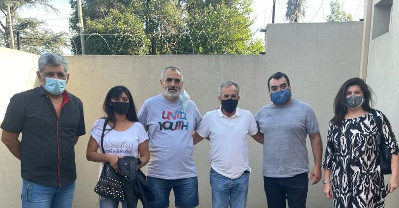 Jesús Cariglino con dirigentes sociales y politicos de 3 de febrero